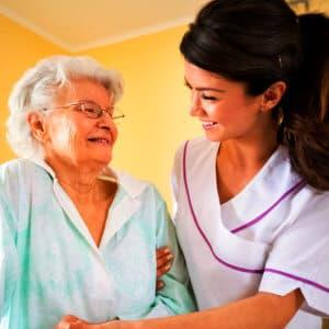 elder woman with caregiver