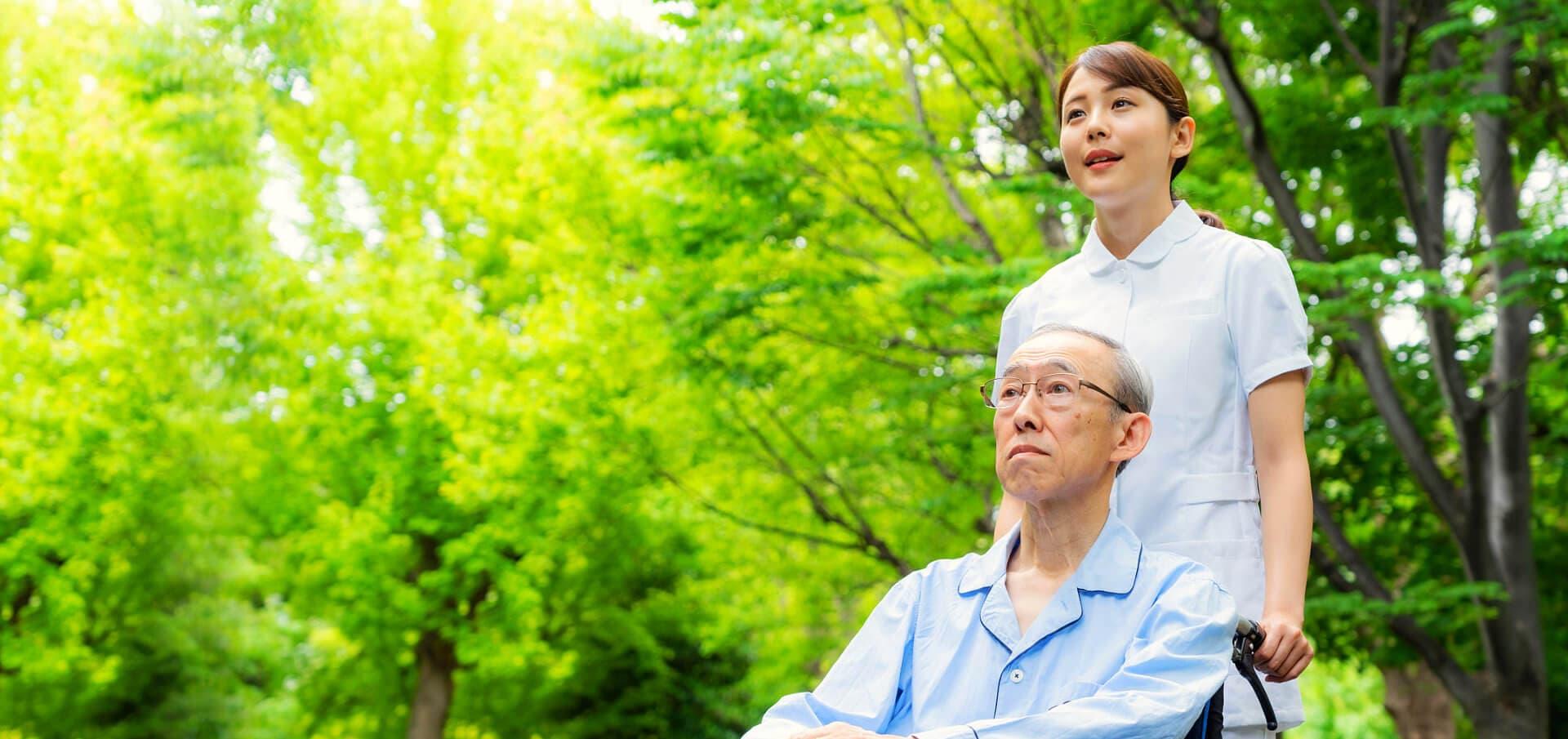 caregiver with elder man on a wheelchair