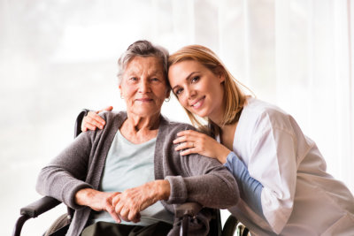 an old lady and a woman smiling