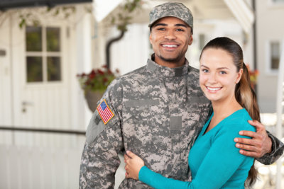 a woman and a soldier smiling