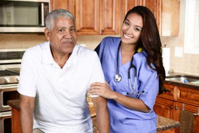 a nurse helping an elderly