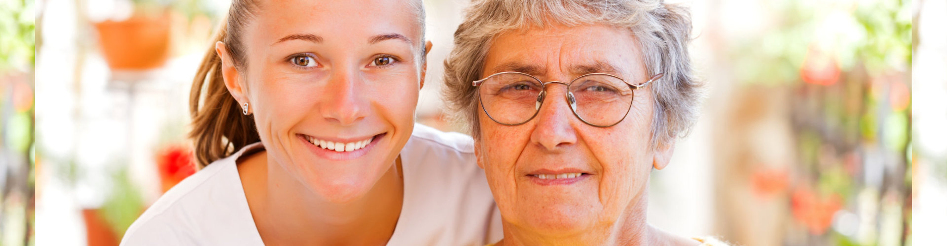 a nurse and an old lady smiling