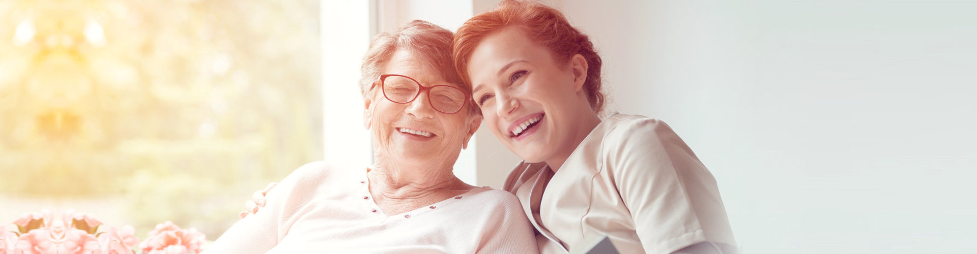an elderly and a woman smiling
