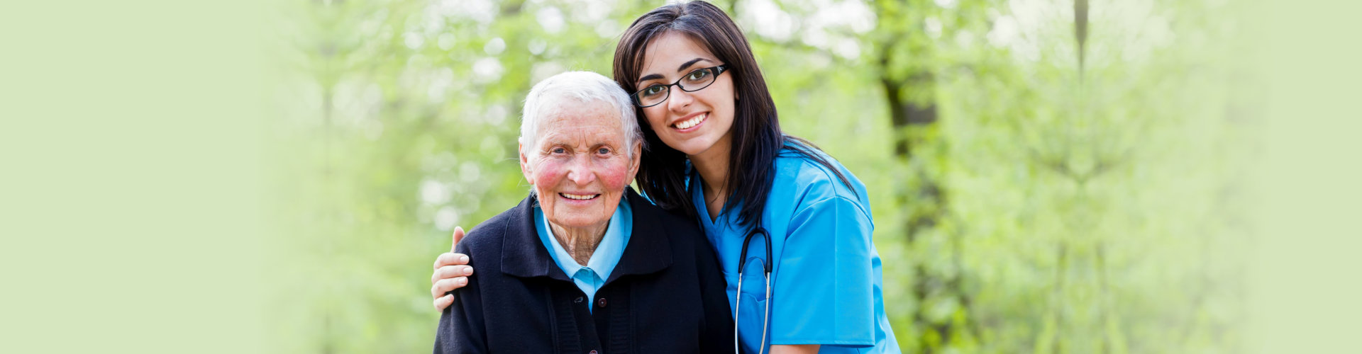 caregiver with elder woman outdoors