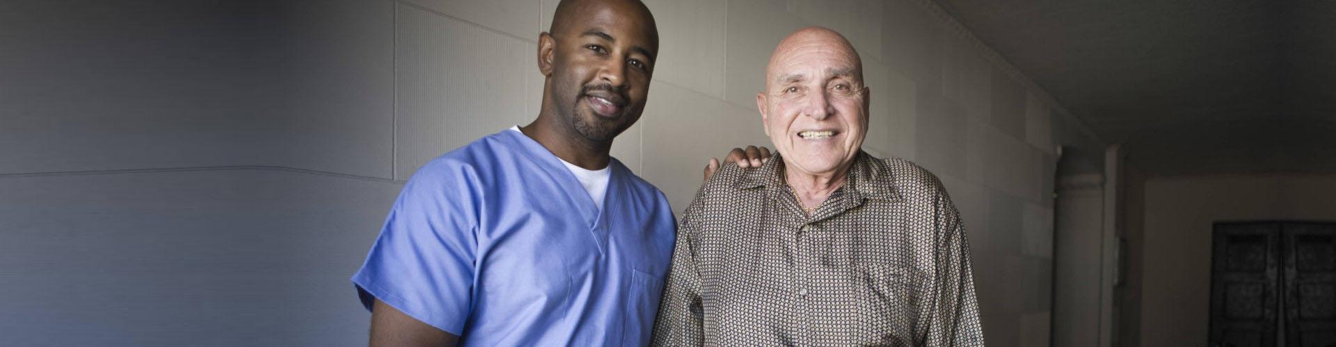 elder man and adult caregiver